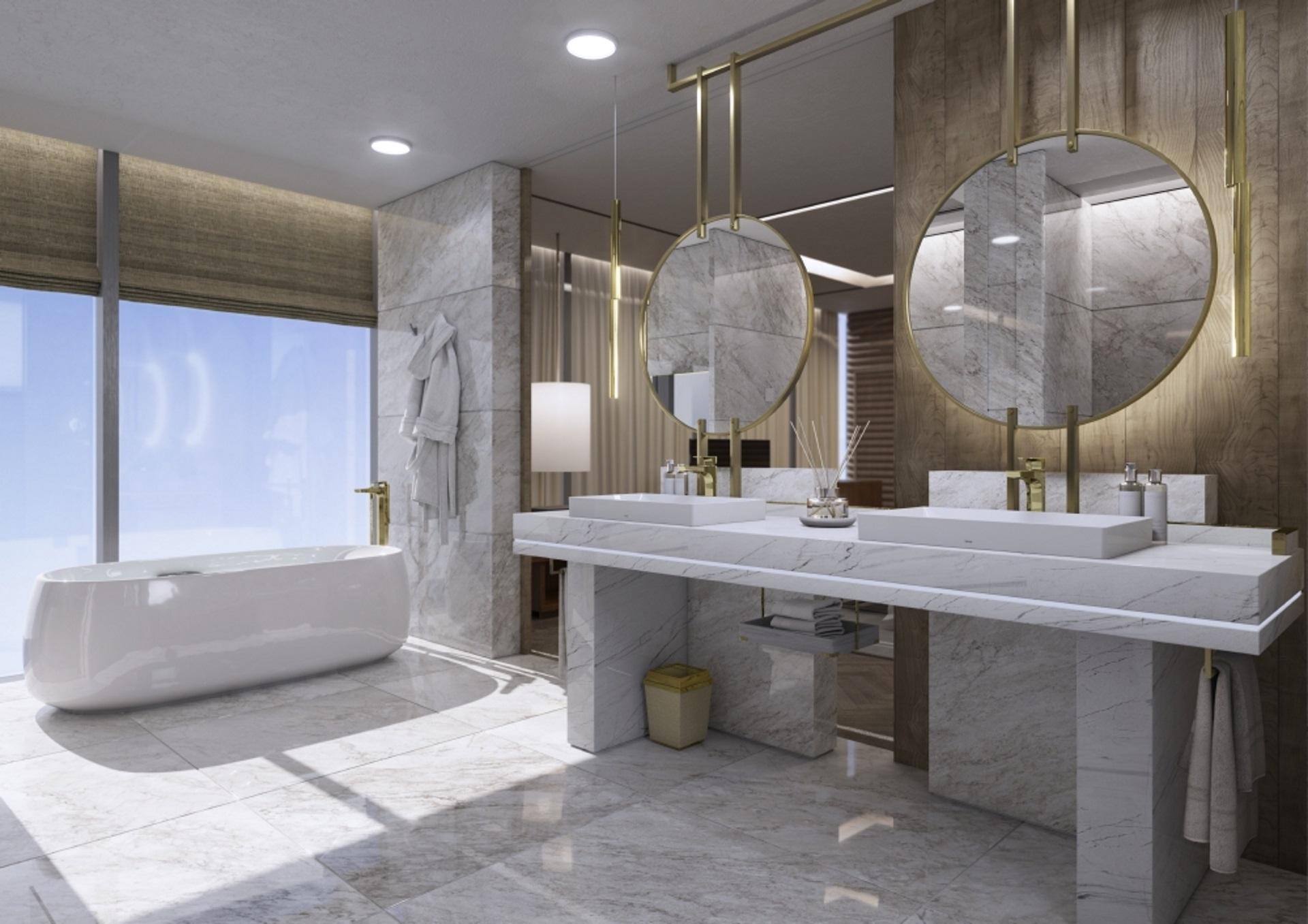 Abbildung klassisches Badezimmer von TOTO mit Marmorfliesen, freistehender Badewanne und zwei Waschbecken mit Armatur