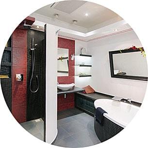 Abbildung Badezimmer mit schwarzen und roten Elementen